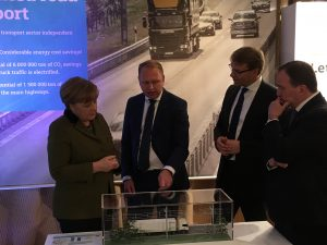 Angela Merkel is briefed on Swedens eHighway trials (photo - Siemens)